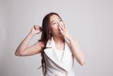 Sleepy young Asian woman yawn. - 182363619