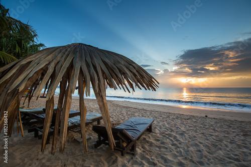 Fotobehang Strand Sun loungers with umbrella on the beach, sunrise