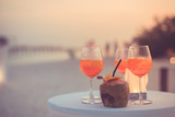 Exotic summer drinks, blur sandy beach with people having fun talking, chilling on background - 182376404