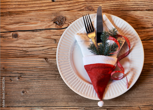 Decorative Christmas place setting on a wood table