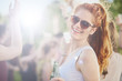 Ginger girl drinking, dancing and having a good time at outdoor party