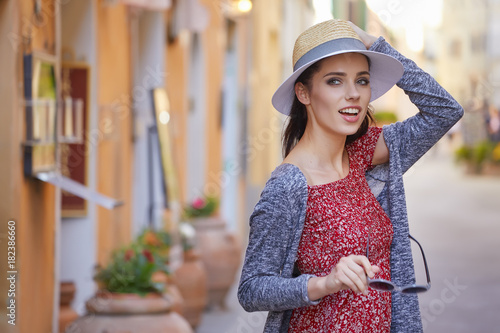 Staande foto Toscane Fashionably dressed woman on the streets of a small Italian town