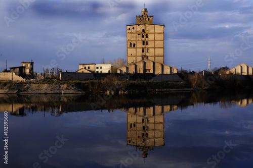 Fotobehang Oude verlaten gebouwen Abandoned places,plant water reflection