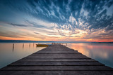 Lake sunset / Magnificent long exposure lake sunset with boats and a wooden pier