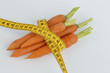 fresh carrots with measure tape - 182403206