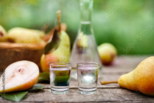 Pear brandy in two shot glass