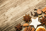 Christmas spices  -  Flat lay, background with cinnamon, anise, cookie and other - 182407846