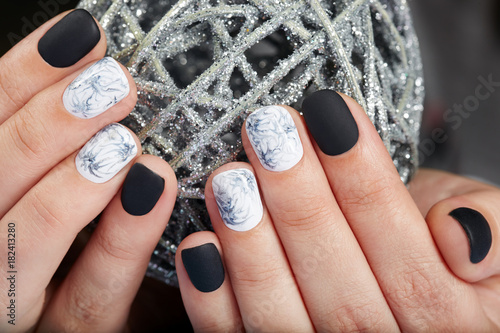Poster Manicure Hands with short manicured nails colored with black and white nail polish