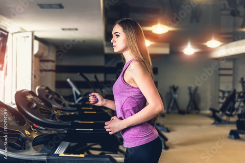 Sticker Long hair pretty girl training in the gym