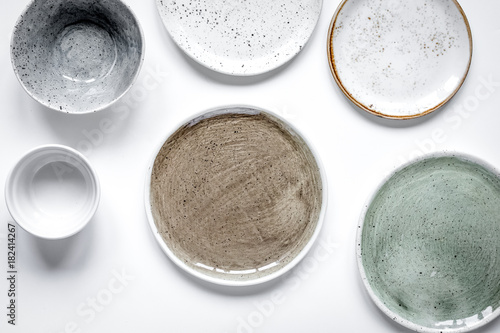 Poster ceramic tableware top view on white background mock up