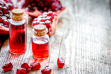 sliced pomegranate and extract in glass on wooden background - 182414418