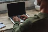african american man typing on laptop - 182415671