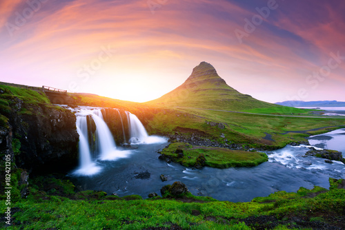 Picturesque icelandic landscape with colorful sunrise on Kirkjufellsfoss waterfall. Amazing morning scene near famous mountain - Kirkjufell volkano, Iceland, Europe - 182421205
