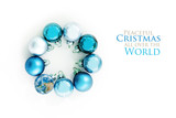 blue Christmas balls and an earth globe in a circle, isolated with shadows on a white background, text Peaceful Christmas all over the World, one element provided by NASA, flat top view from above - 182423234