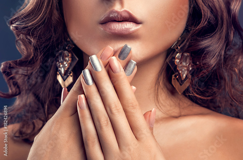 Plexiglas Manicure Beautiful woman with pink and silver manicure and perfect makeup