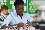 Female Pupil Using Molecular Model Kit In Science Lesson - 182427232
