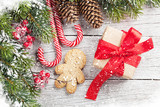 Christmas gift, gingerbread man, candy canes and fir tree - 182433425