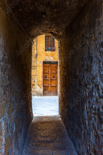 Tuinposter Smal steegje Dark mysterious old narrow alley to the street