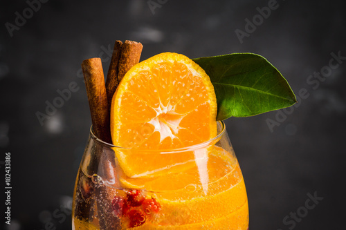 Homemade sangia with tangerines and pomegranate on the rustic background. Selective focus. Shallow depth of field.