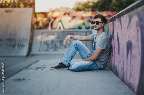 Young man at skate park Poster