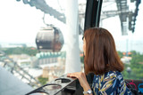 Asian girl in cable car looking the beautiful scenery. Woman riding cable car - 182448212