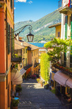 Picturesque and colorful old town street in Italian city of Bellagio - 182455033