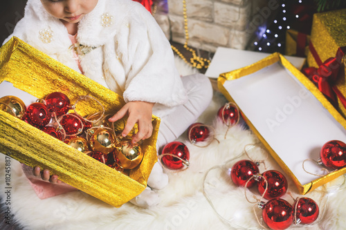 Closeup little girl decorating Christmas tree