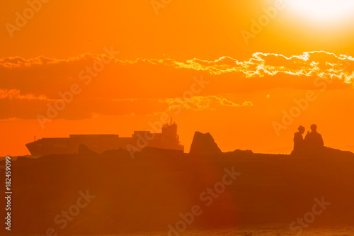 Foto op Canvas Baksteen Tramonto sul mare