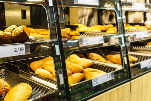 Fresh bread on store shelves with prices