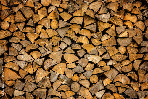 Keuken foto achterwand Brandhout textuur pile of wood ready for winter fireplace heating