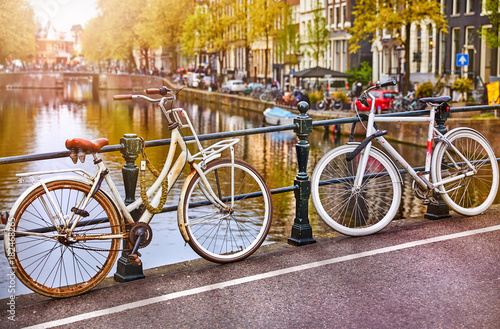 Foto op Canvas Amsterdam Bike over canal Amsterdam city. Picturesque town landscape
