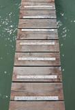 wooden walkway suspended above sea