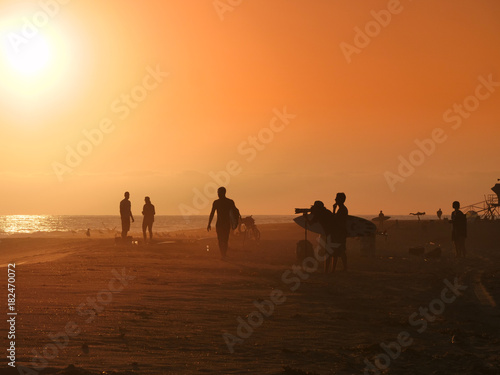 Golden hour on the California beach, surfers, photographers, people Poster
