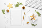 Christmas home office desk with computer, notebook, pine branches, christmas gold decorations. Flat lay, top view, copy space. - 182472051