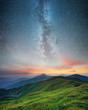 Mountain range and night sky. Natural summer landscape.