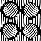 A repetitive abstract geometric black and white pattern drawn by a brush - 182477412