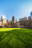 Green Lawn and Skyline with Skyscrapers viewed Bryant Park NYC - 182478436