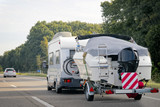 Caravan with trailer for motor boats road in Switzerland - 182478634