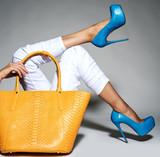 Part of women legs in beautiful fashionable high heels - 182480657