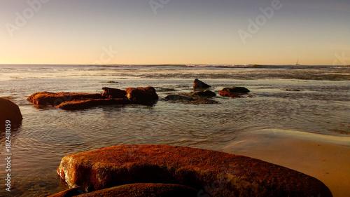 Deurstickers Zee zonsondergang Exposed Rocks along the Seashore