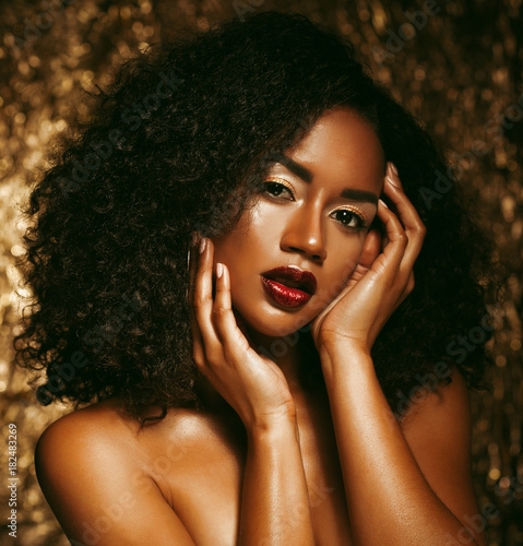 Stunning Portrait of an African American Black Woman over golden background Poster