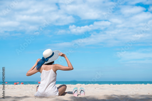 Sticker Woman in sun hat relaxing at sunny beach Tropical and remote beaches