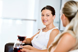 Female friends with glass of wine - 182486673