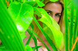 Leinwanddruck Bild - Blonde girl in the midst of green