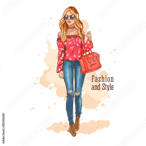 Fashion look. Urban casual outfit. Shirt with print and jeans. Young stylish woman with a bag in sunglasses. Hand drawn sketch. Vector illustration.