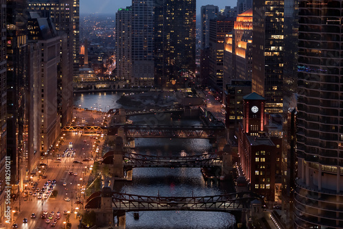 Poster Chocoladebruin Aerial view of downtown Chicago at night with the river, bridges and city traffic.
