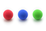 Red, Blue, Gree Small Sponge Balls on White Background