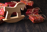 wooden horse in front of a bunch of presents - 182504425