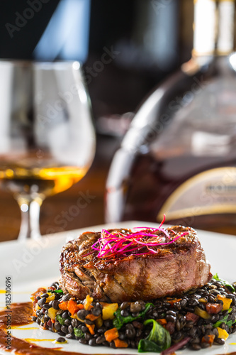 Fotobehang Steakhouse Beef Steak. Grill beef steak black lentils mixed with vegetable. Cognac or brandy as drink. Culinary food in hotel pub or restaurant