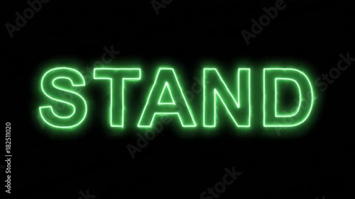 Neon flickering green text STAND in the haze. Alpha channel Premultiplied - Matted with color black